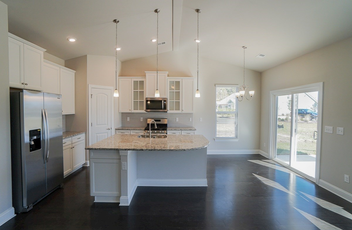 Savannah quick move-in kitchen provides granite countertops and vaulted ceilings