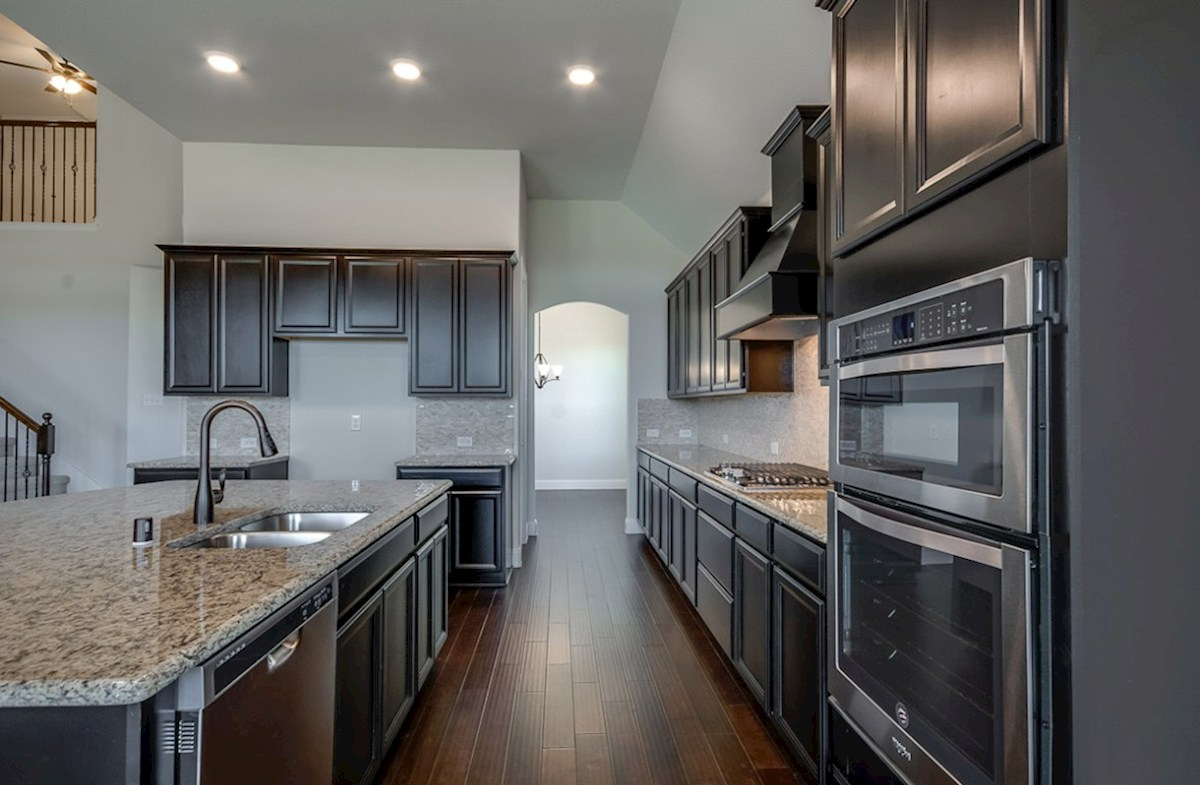 Kerrville quick move-in espresso kitchen cabinets and stailess steel appliances