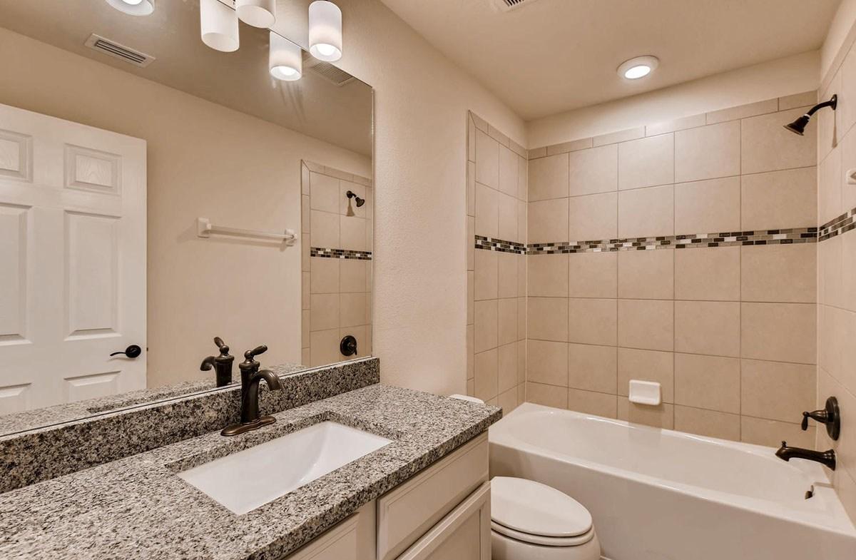 Sea Breeze quick move-in Secondary bathroom with listello tile