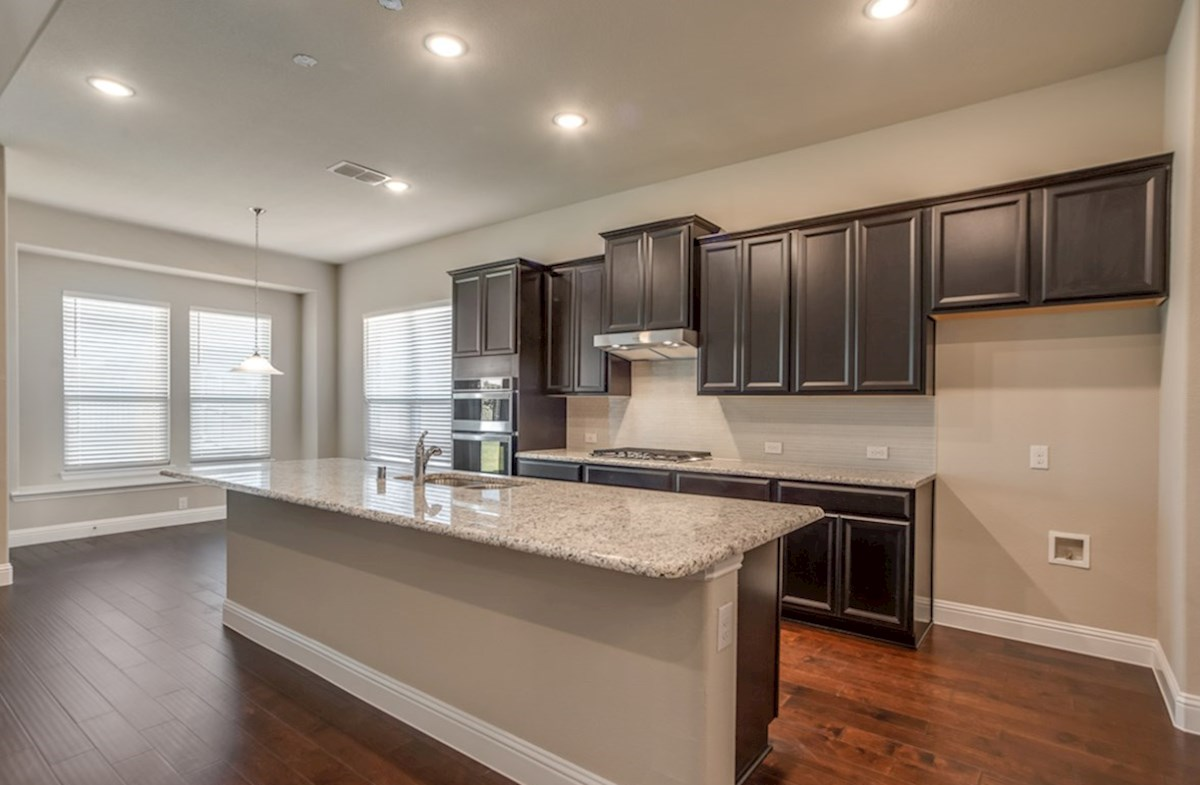 Summerfield quick move-in Summerfield kitchen with large island