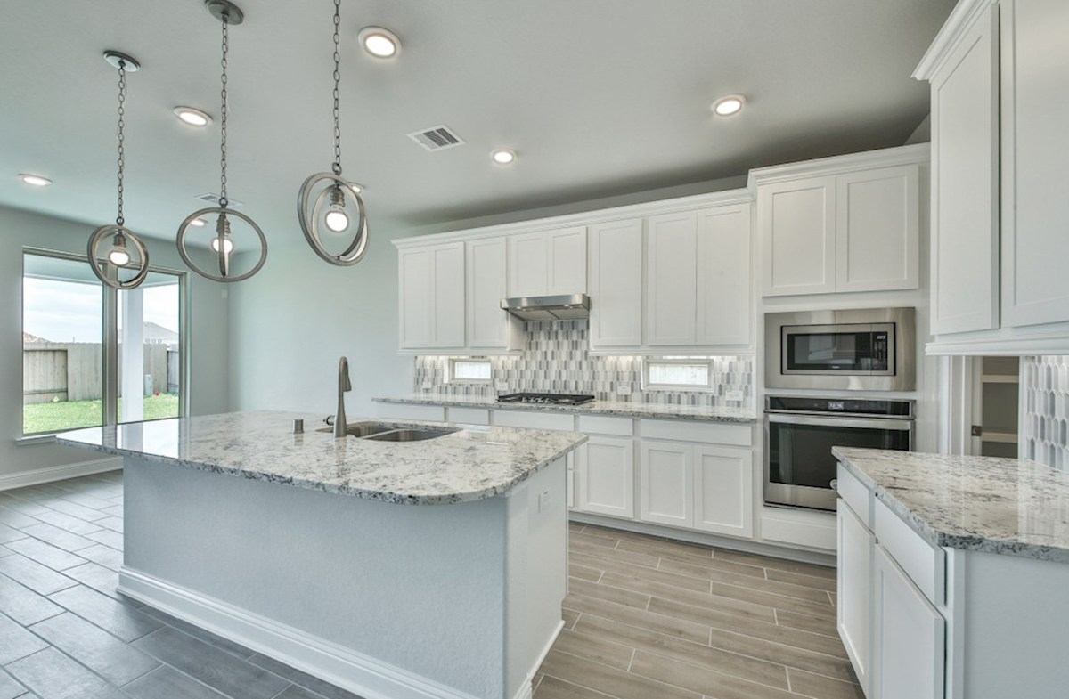 Biltmore quick move-in kitchen with white cabinetry and pendant lighting
