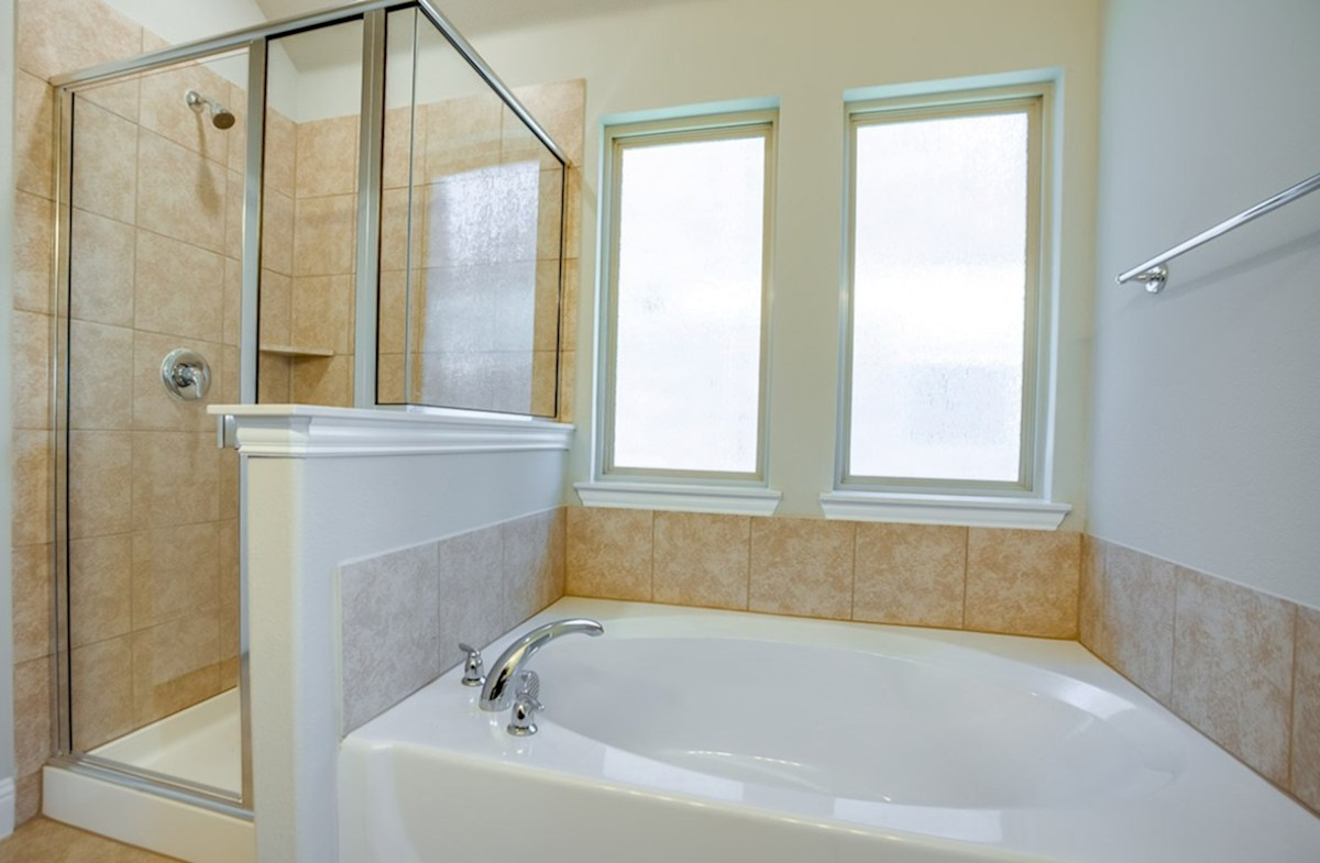 Woodcreek Baxter Baxter master bathroom with separate tub and shower