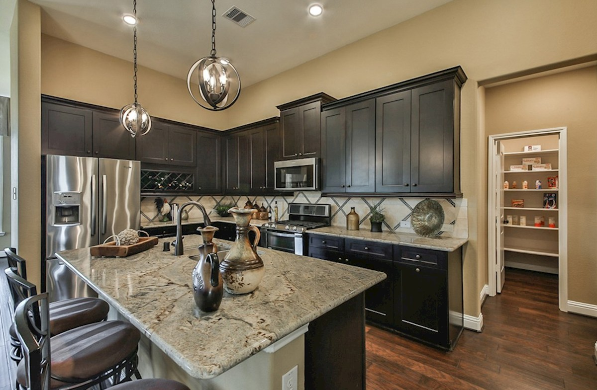 Galveston quick move-in Galveston kitchen with granite countertops and wood flooring