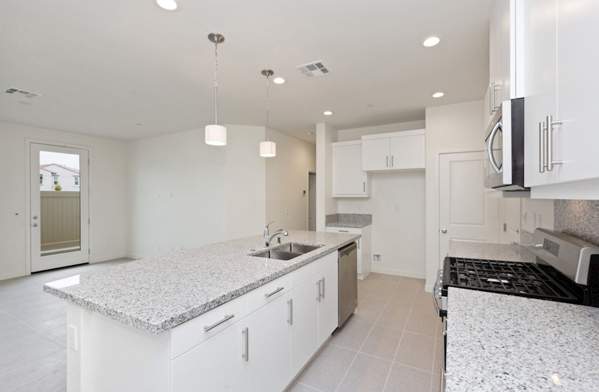 Snowberry quick move-in Enjoy casual dining in open-concept kitchen