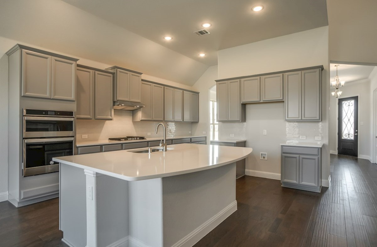 Kerrville quick move-in open kitchen with large island and grey cabinets