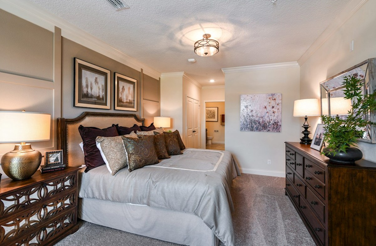 Gatherings® of Lake Nona Aspen with Study relaxing master bedroom