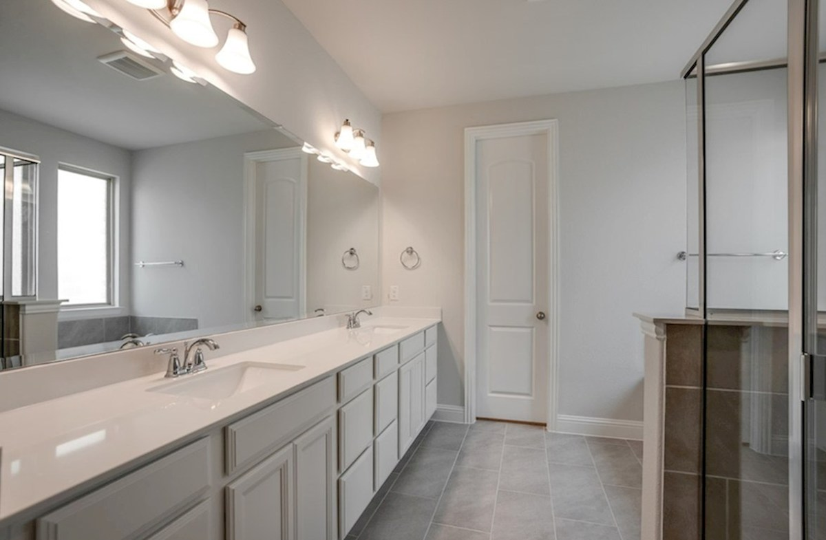 Summerfield quick move-in master bathroom with walk-in shower and soaking tub