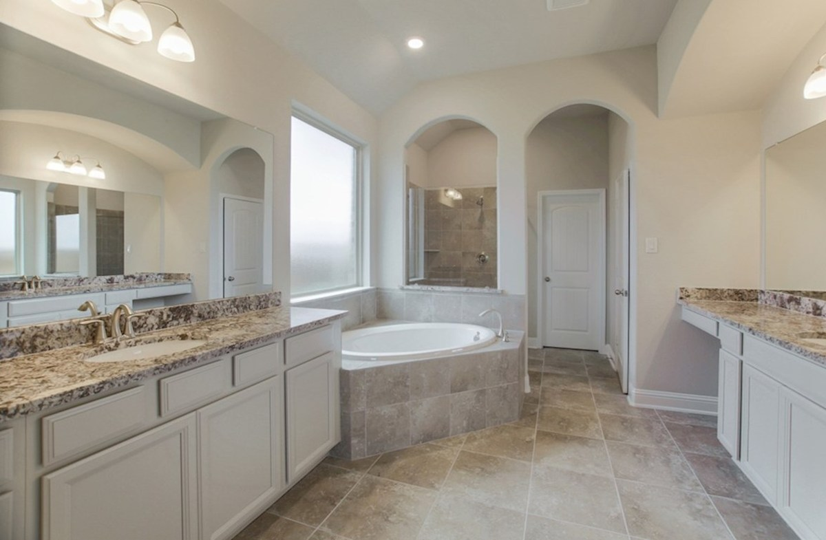 Fredericksburg quick move-in master bathroom with separate tub and shower