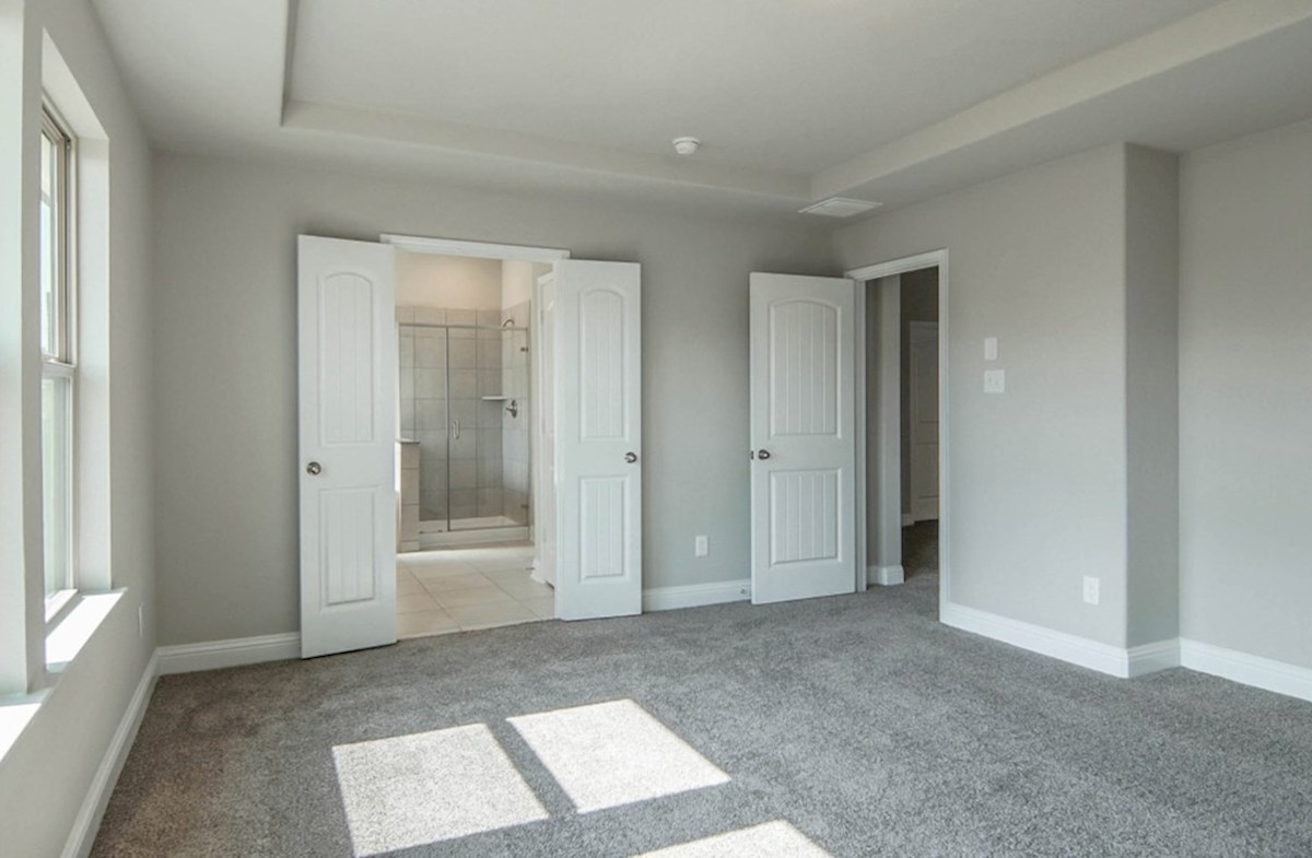 Sycamore quick move-in master bedroom with tray ceiling