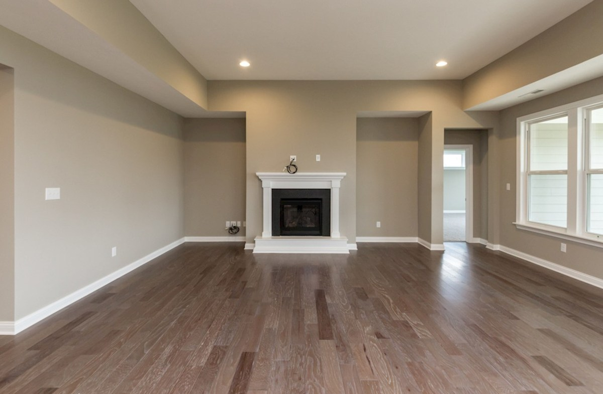 Cambridge quick move-in Great room boast hardwood floors and cozy fireplace
