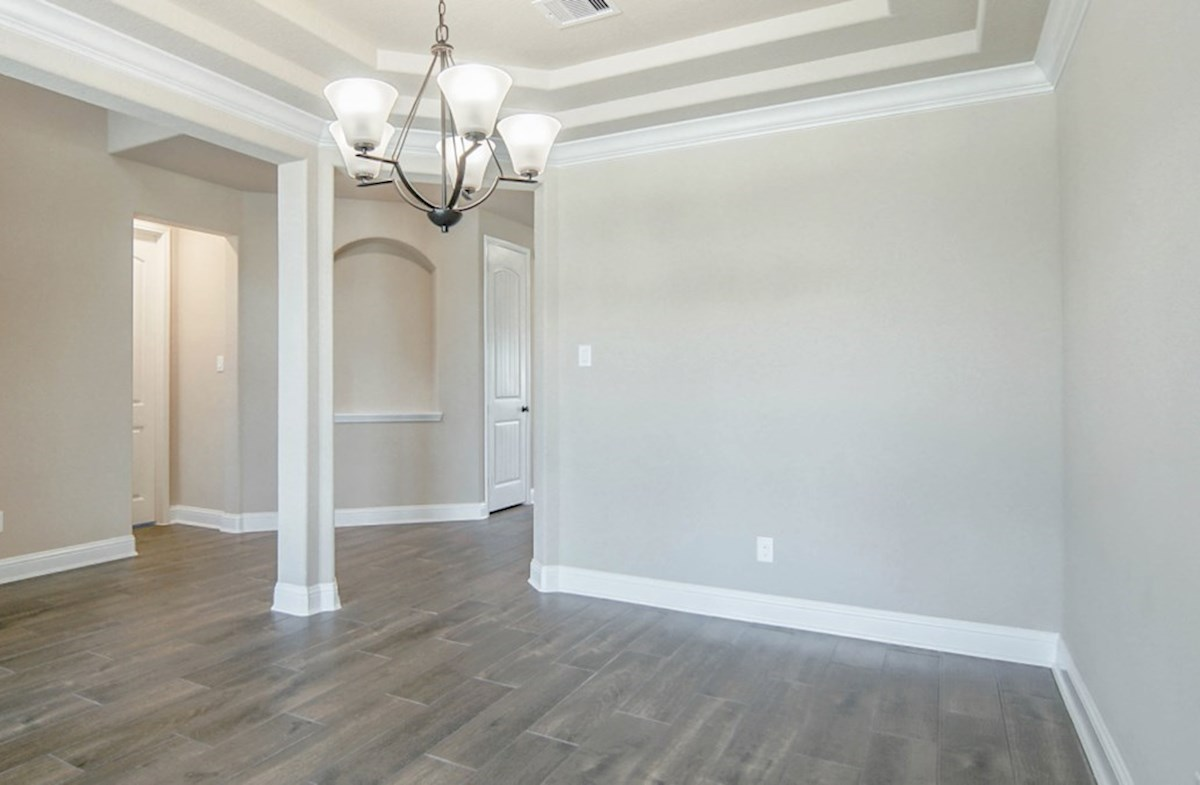Lockhart quick move-in formal dining room with tray ceiling