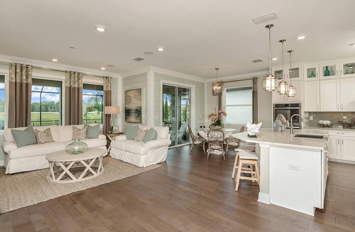 Reserve at Citrus Park Lucia Bay Great room and kitchen with coastal decor