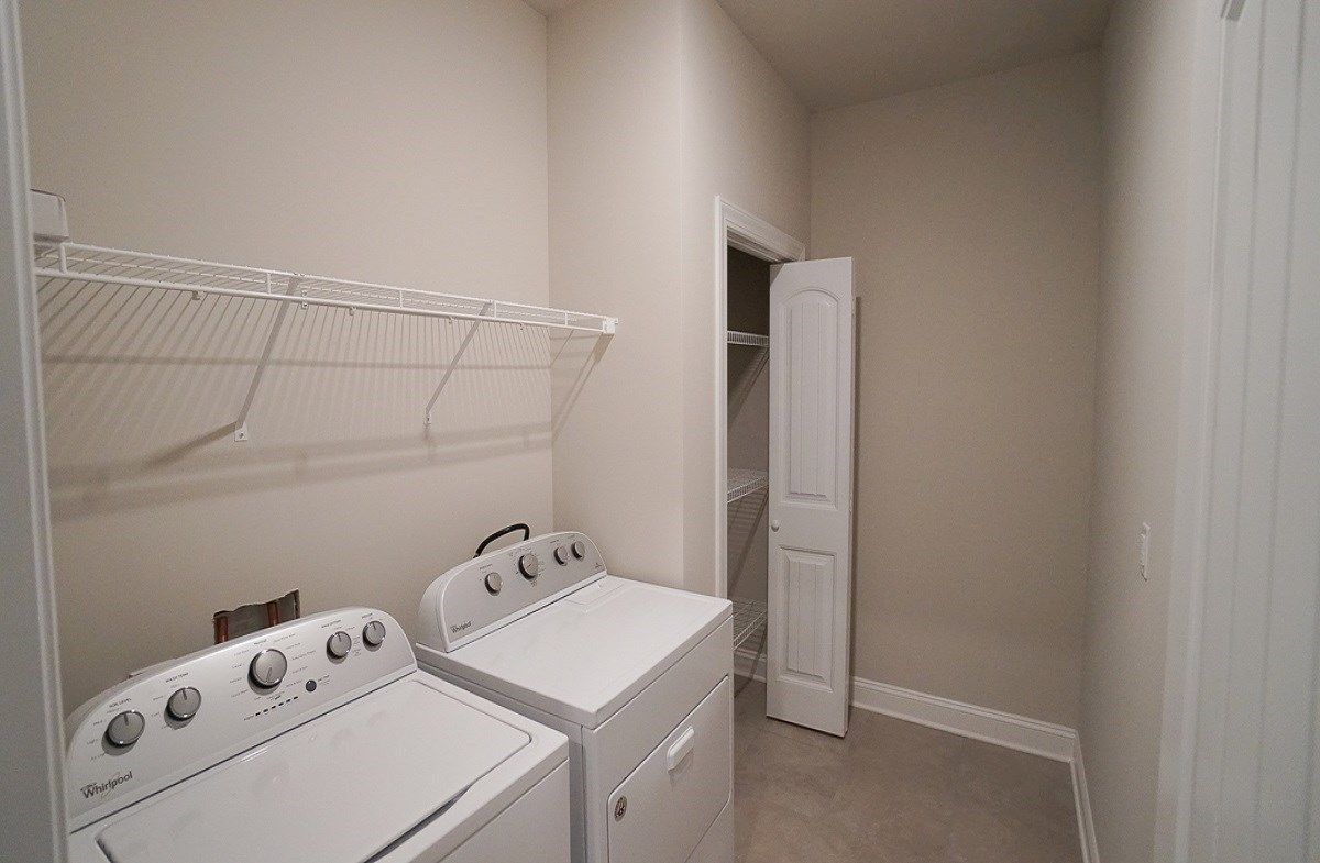 Savannah quick move-in laundry room is spacious with plenty of storage