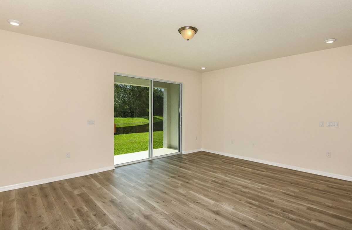 Siesta Key quick move-in Great room with large sliding glass door to lanai