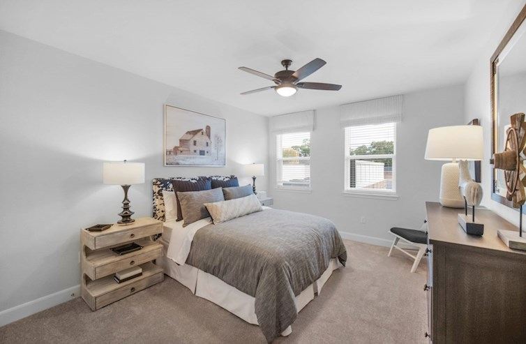 Dorset secondary bedroom with carpet floors and ceiling fan
