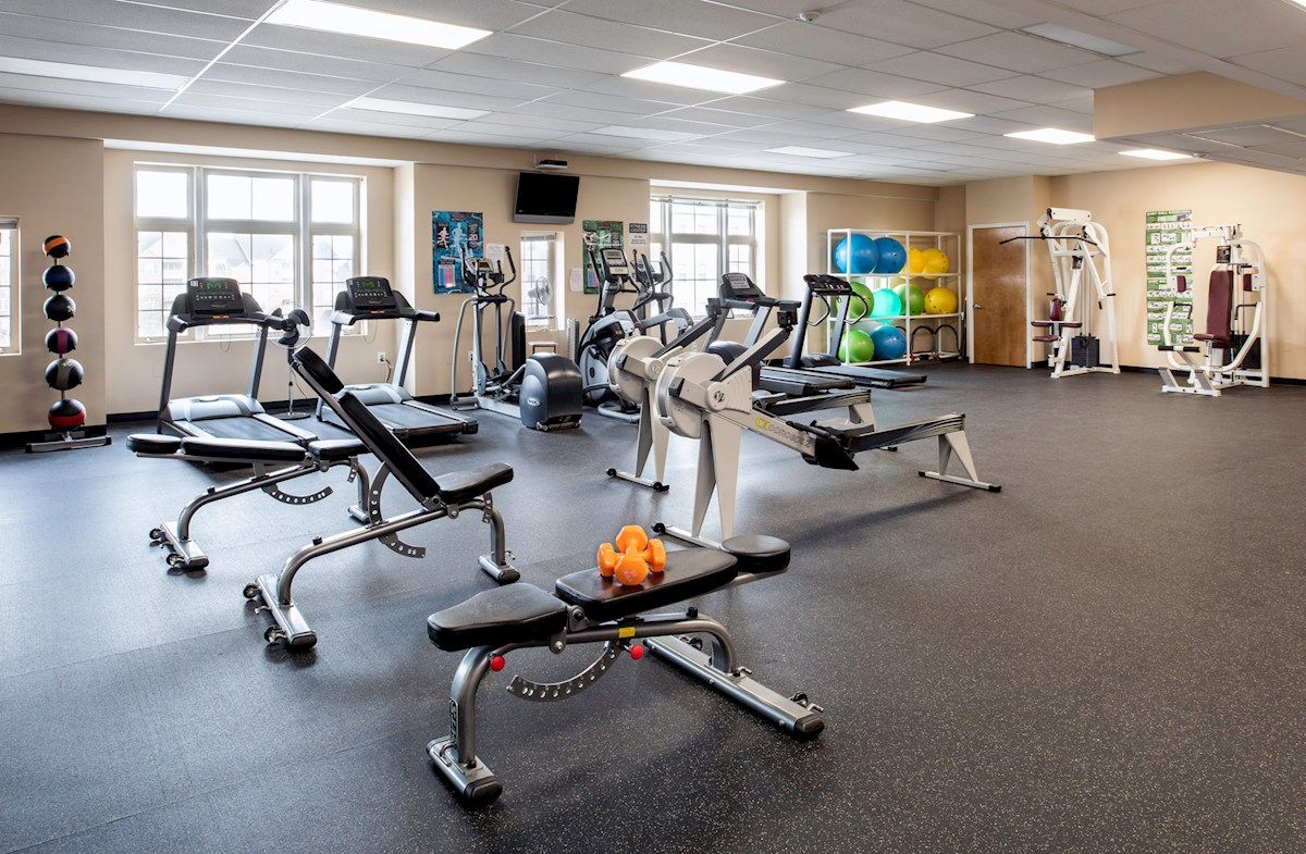 Fitness center featuring yoga mats and equipment