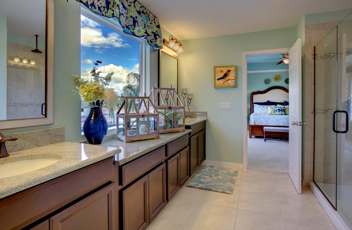 The Reserve at Pradera Anna Maria Master bathroom with dual sinks and walk-in shower