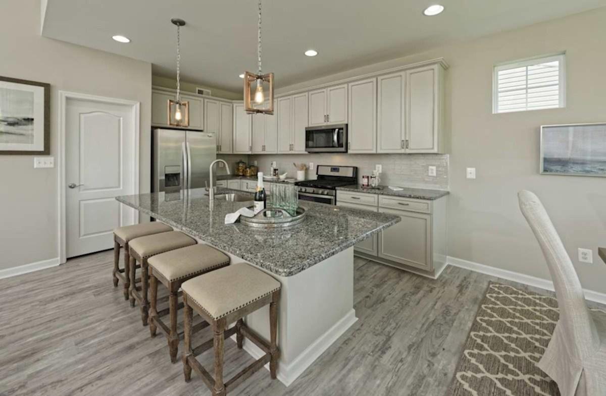 Bishop's Landing Magnolia Magnolia kitchen featuring granite and stainless steel