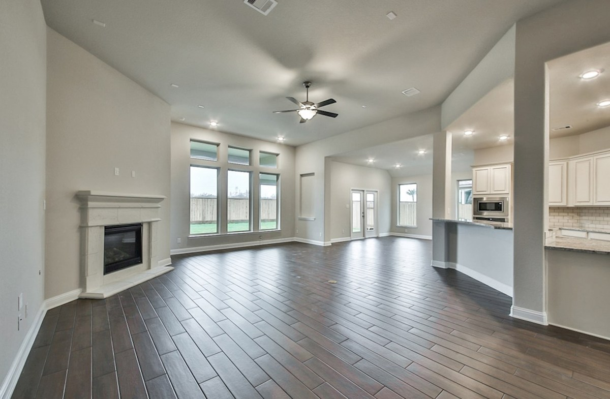 Fredericksburg quick move-in great room with fireplace and tile flooring