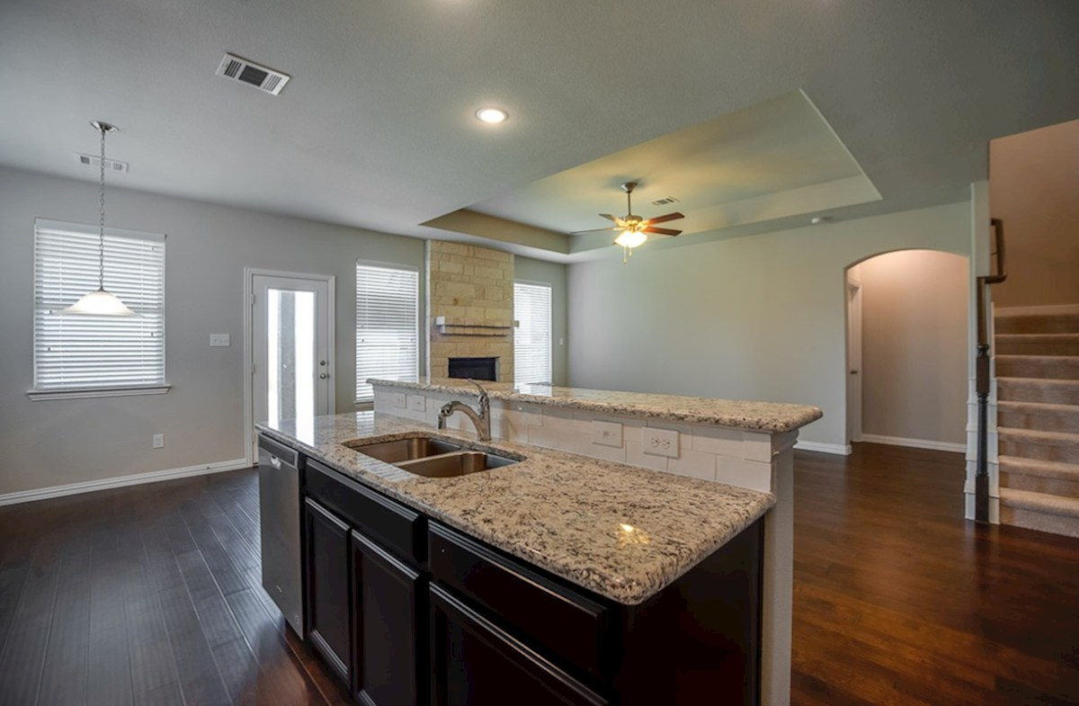 Avalon quick move-in kitchen island overlooks great room