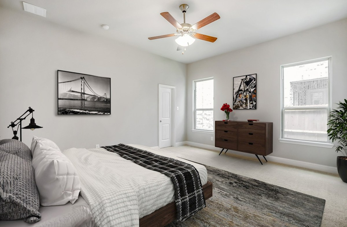 Valencia on the Lake Brenham Brenham master bedroom with natural lighting