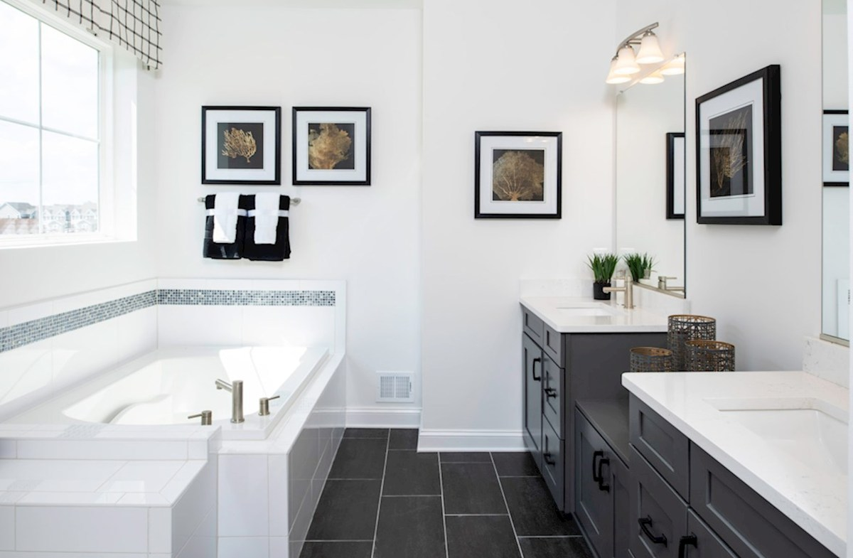 Bishop's Landing Wilmington Spa-inspired master bath featuring two individual vanities
