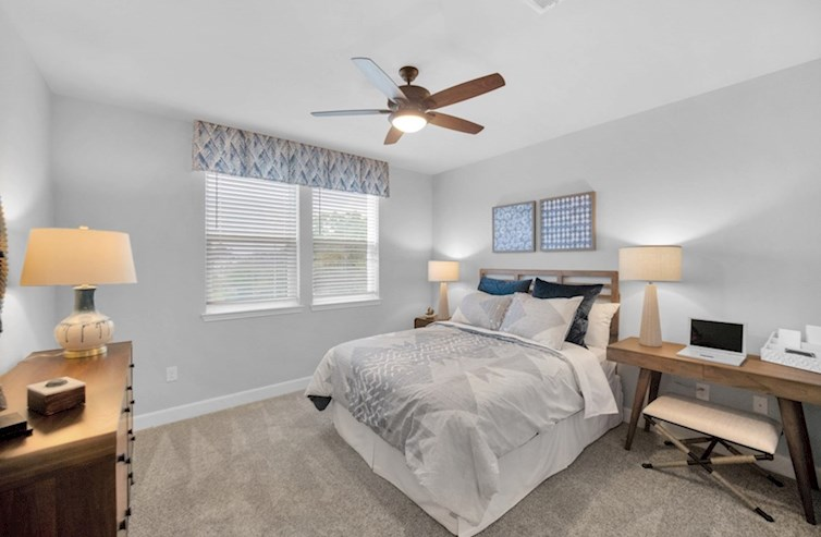 Clifton secondary bedroom with carpet floors and ceiling fan