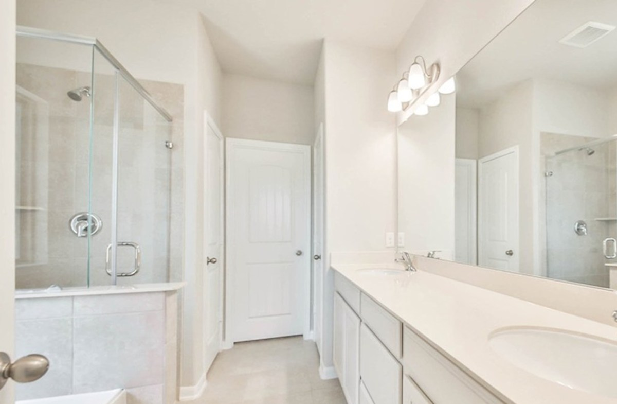 Maxwell quick move-in master bath with tile floors and double vanities