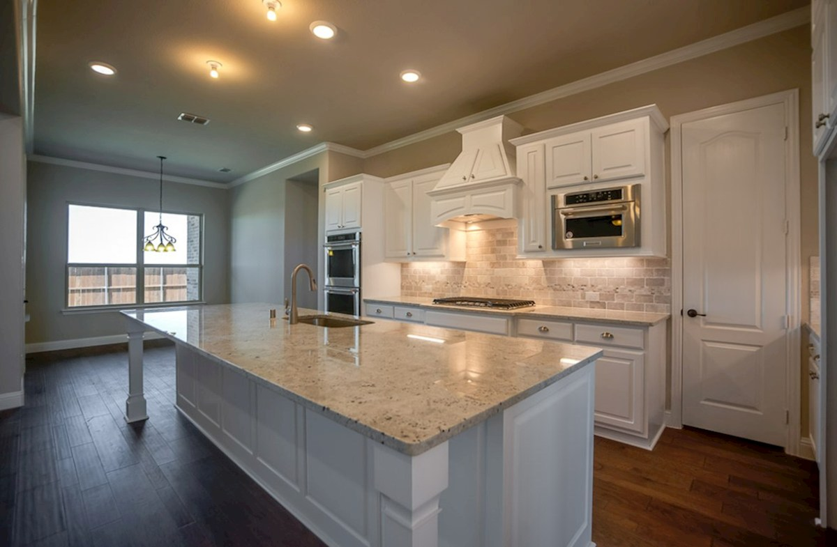Calais quick move-in kitchen with large island and granite countertops