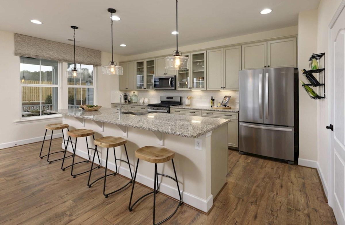 Heron's Ridge at Bayside Rehoboth Rehoboth kitchen featuring stainless steel appliances
