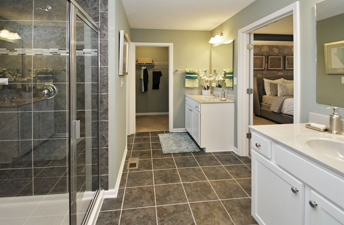 Heritage at Vermillion Jefferson master bath with white vanities and spa shower