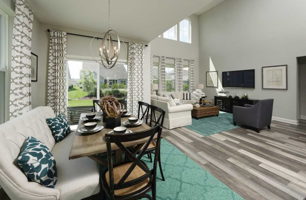 The Estuary Newport Breakfast area overlooks the family room and features hardwood floors