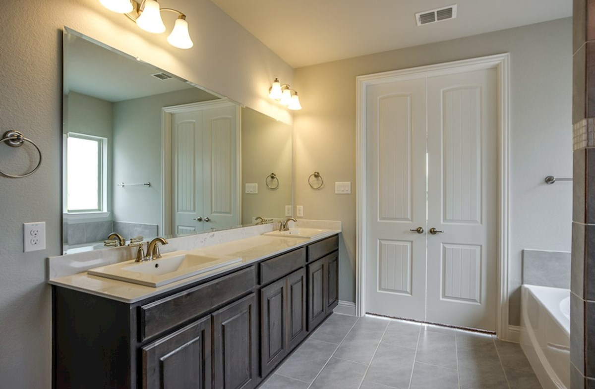Trinity quick move-in master bath includes dual vanities