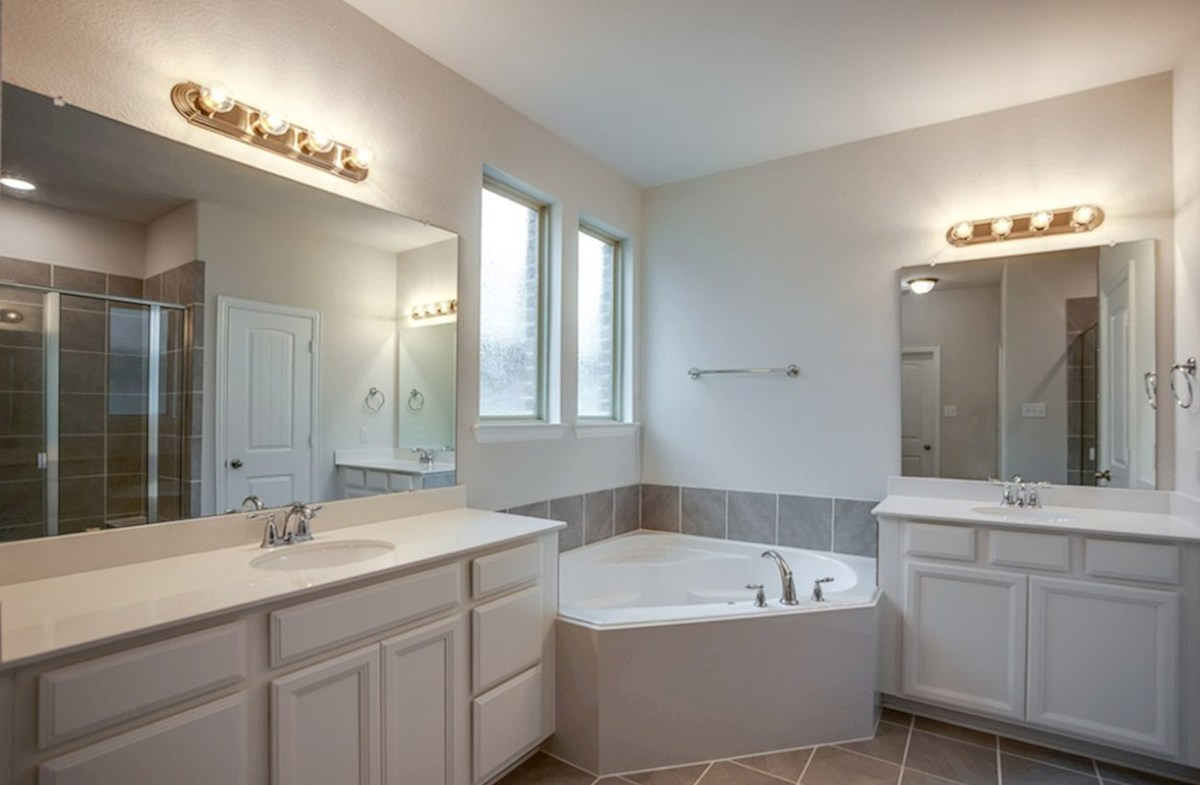 Blakely quick move-in master bath with grey cabinets and separate vanities