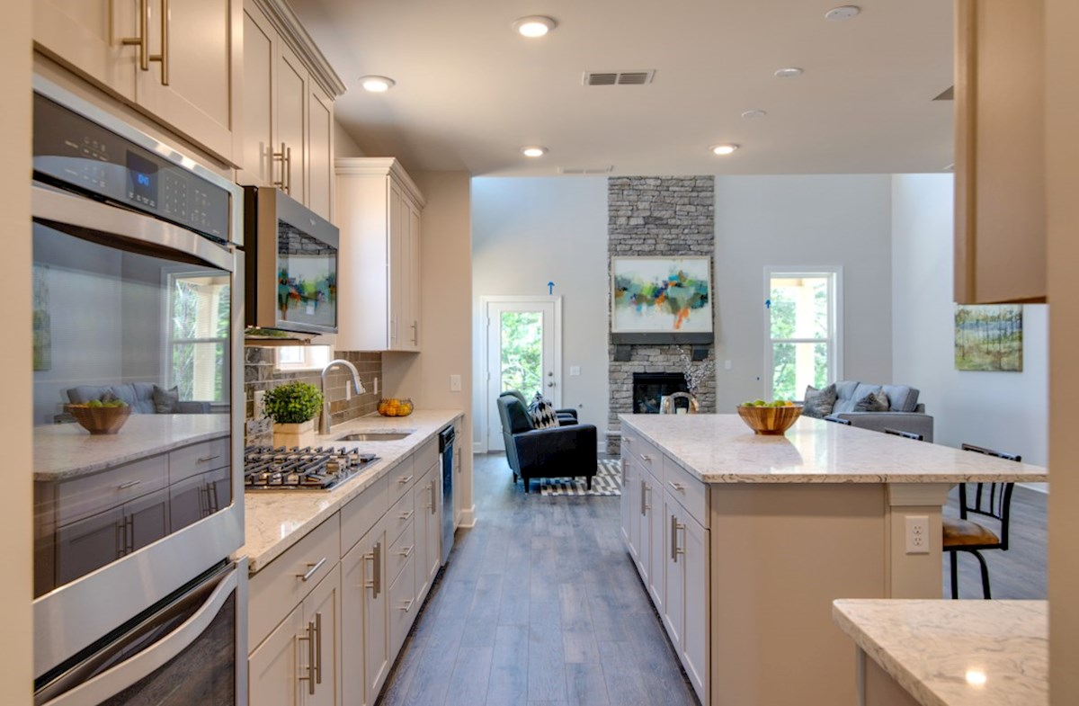 Nichols Vale Dogwood open kitchen with white cabinets and center island