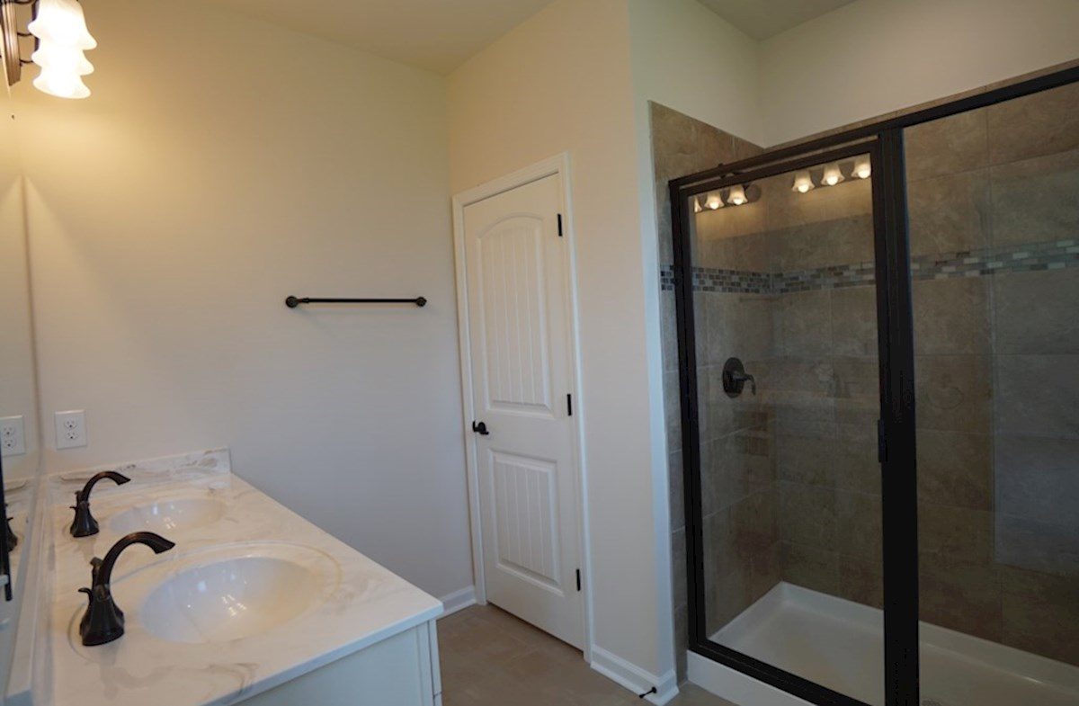 Lexington quick move-in master bathroom with raised double vanities