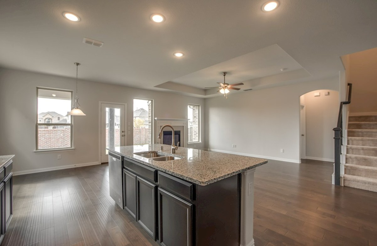 Avalon quick move-in open kitchen and great room with wood floors