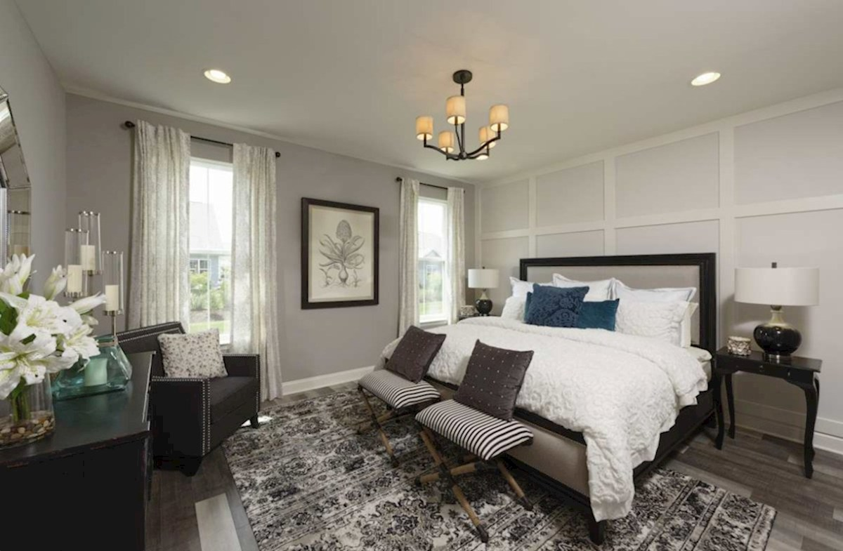 The Estuary Newport Private master suite located on the first floor featuring carpet