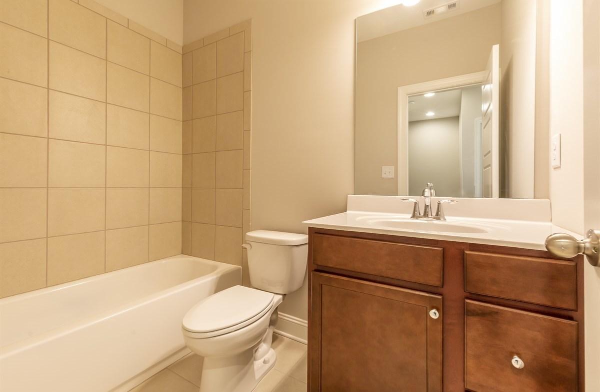 Ashland quick move-in Secondary Bathroom with granite countertops