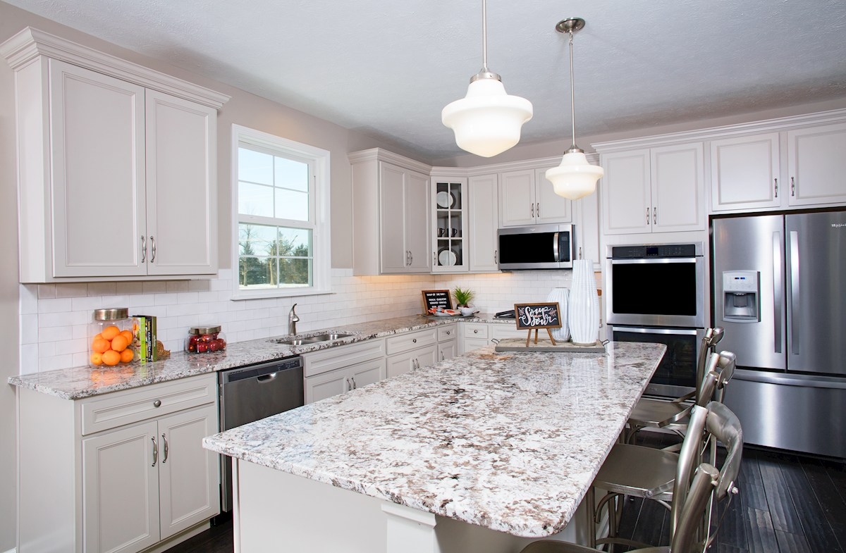 Hampshire Crossroads Collection Lawrence kitchen with white cabinets and quartz countertops