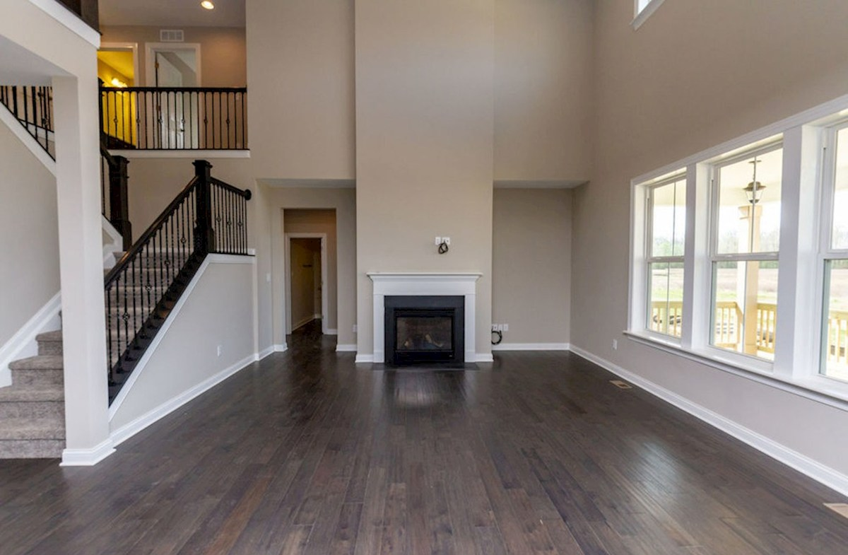 Keystone quick move-in Great room with fireplace and hard wood floors