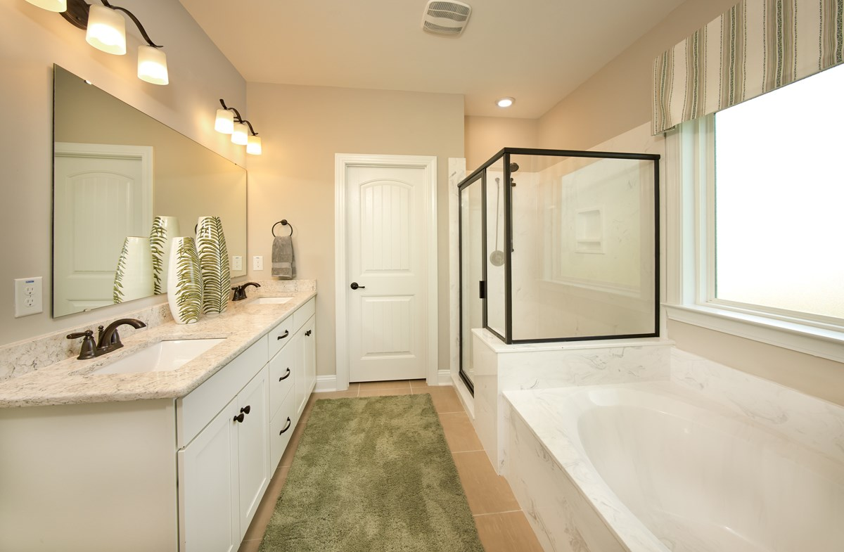 bathroom features walk-in shower and bathtub