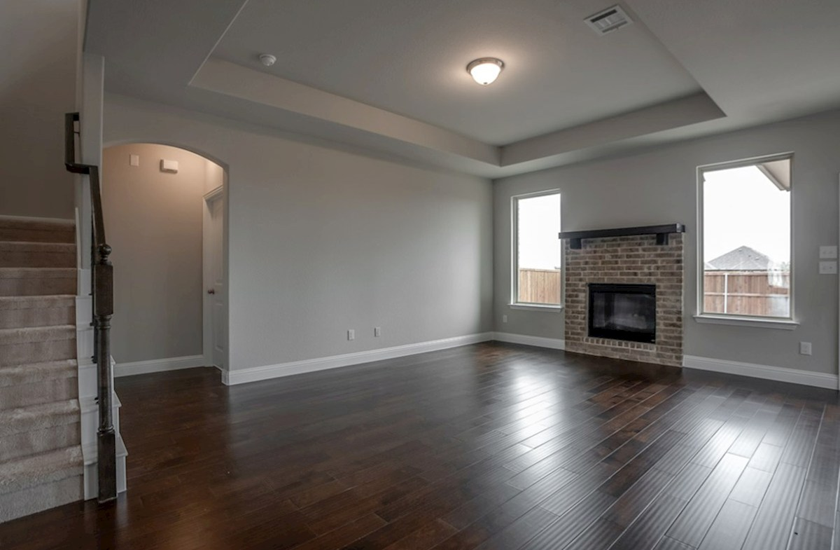 Avalon quick move-in great room with cozy brick fireplace