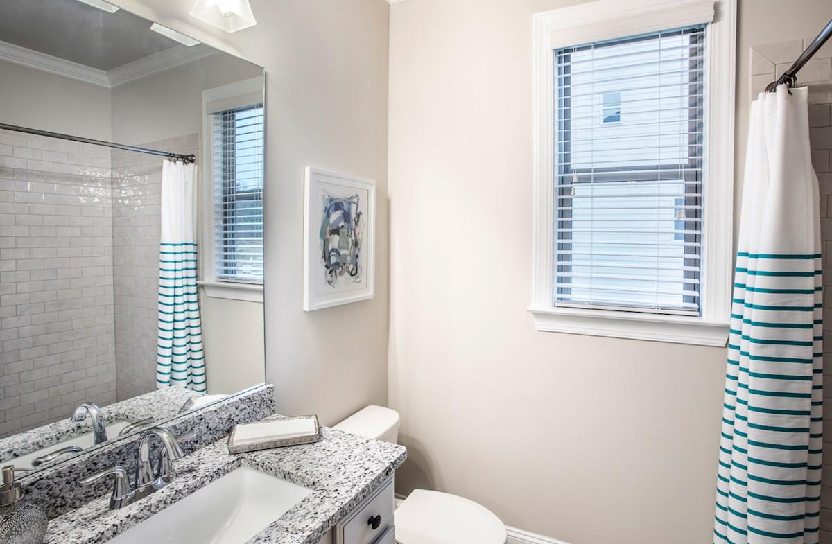 Secondary Bathroom with granite countertops