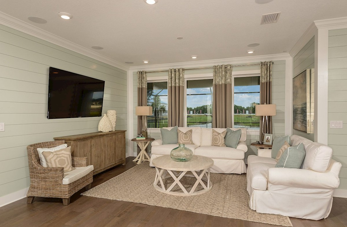 Reserve at Citrus Park Lucia Bay great room with large windows and coastal decor