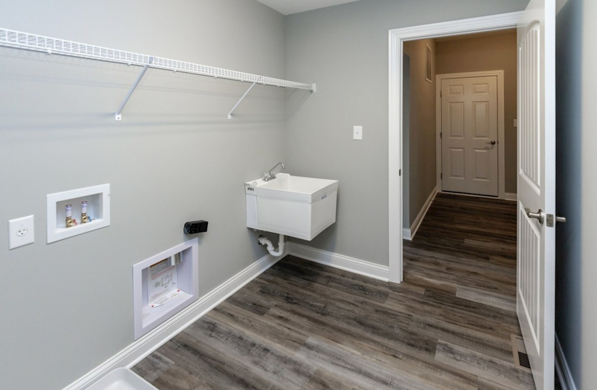Charleston quick move-in laundry room on main floor with sink
