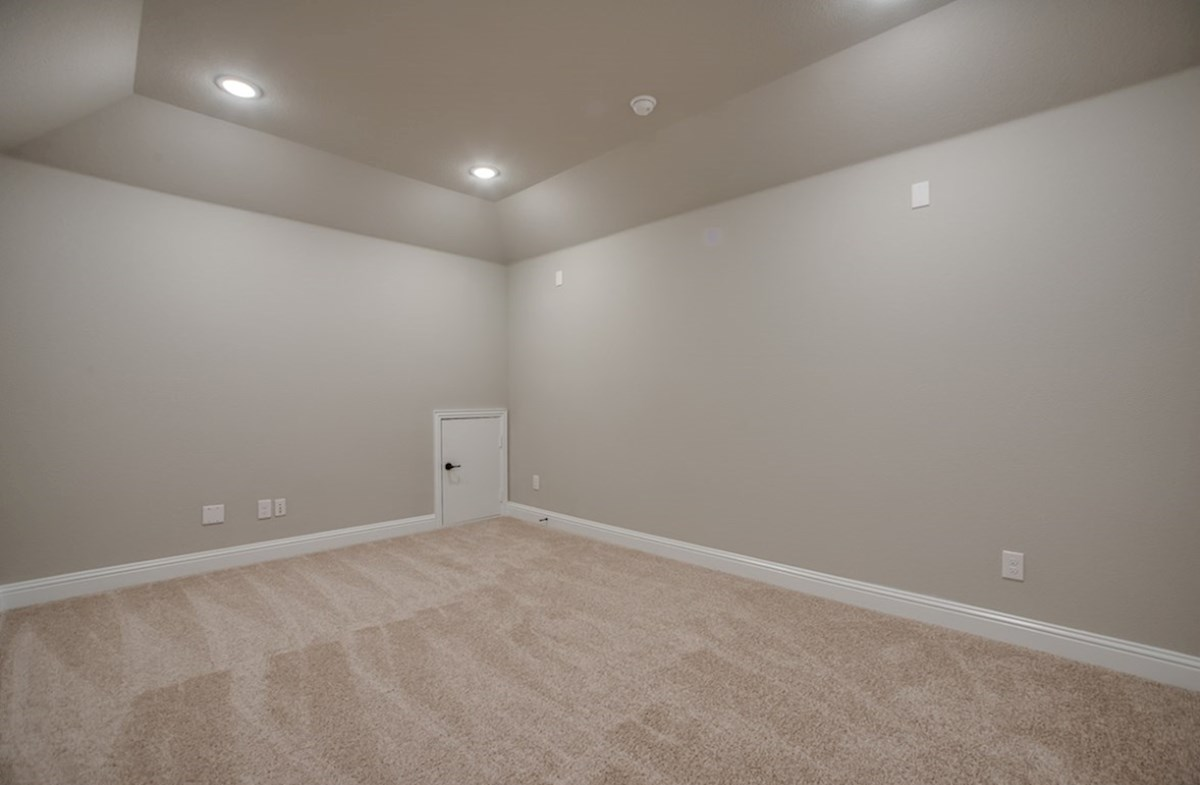 Summerfield quick move-in large media room with carpet