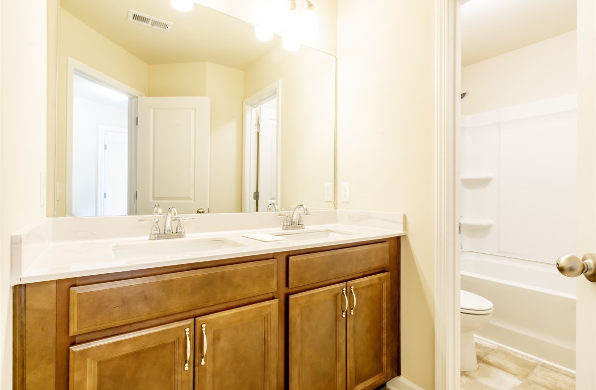 Ridgecrest quick move-in Secondary Bathroom with dual sinks