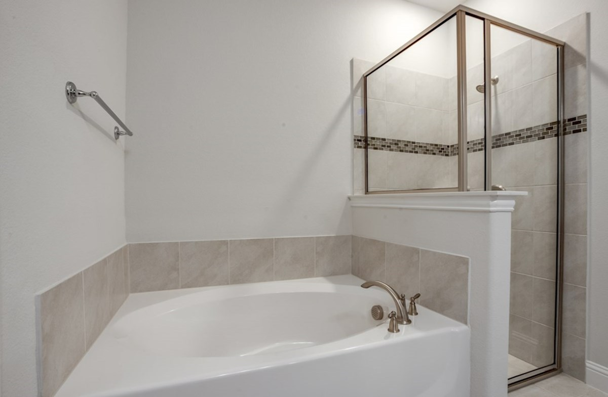 Millbrook quick move-in master bath with separate tub and shower