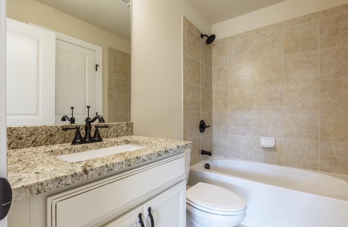 Stockton quick move-in Secondary Bathroom with granite countertops